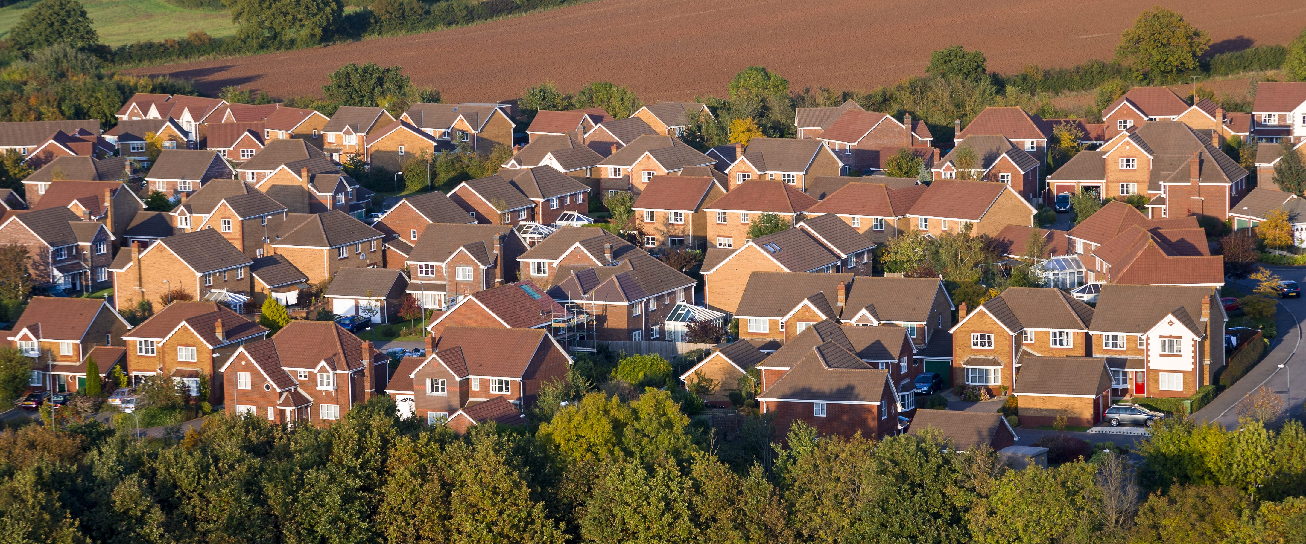 Modern, red brick houses viewed from above.